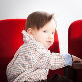 Small baby on armchair — Stock Photo
