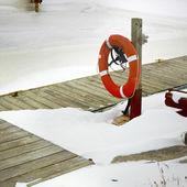 Lifebuoy on pier — Photo