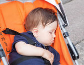 Sleeping boy in pram — Stock Photo
