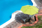 Umbrellas with chairs — Stock Photo