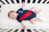 Baby in cot — Stock Photo
