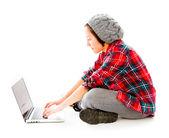 Woman sitting with laptop — Stockfoto