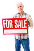 Man with sale sign — Stock fotografie
