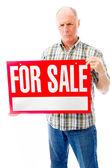 Man with sale sign — Stock Photo