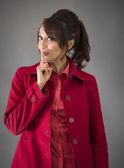 Kvinna med fingret på läppar — Stockfoto