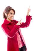 Woman pointing upward — Stockfoto