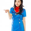 Air stewardess pointing — Stock Photo