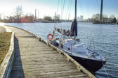Sailboat moored at a pier — Stock Photo