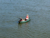 Couple in fishing boat — Stock Photo