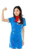 Stewardess flexing biceps — Stock Photo
