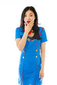 Stewardess with hand over mouth — Stock Photo