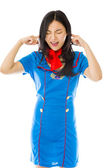 Stewardess with hands in ears — Stock Photo