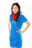 Stewardess with arms akimbo — Stock Photo