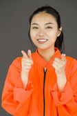 Woman pointing towards camera — Stock Photo