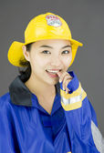 Firefighter with finger in mouth — Stock Photo