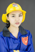 Firefighter wearing yellow helmet — Stock Photo