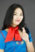 Stewardess crossing fingers — Stock Photo
