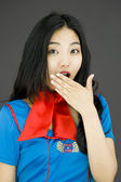 Stewardess with hand over mouth — Foto de Stock