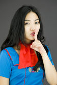 Stewardess with finger on lips — Foto de Stock