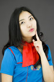 Stewardess with finger on chin — Stock Photo