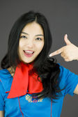 Stewardess pointing at herself — Stock Photo