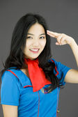 Stewardess pointing fingers to head — Stock Photo