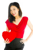 Woman holding heart cushion — Stock Photo