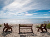 Benches on the beach — Stock Photo