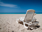 Reclining chairs on the beach — Stok fotoğraf