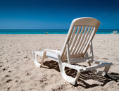 Reclining chair on the beach — Stok fotoğraf
