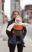 Woman carrying baby boy — Stock Photo