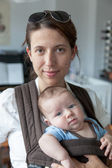 Woman carrying her baby — Stock Photo