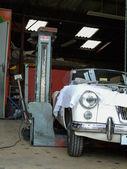 Car in a garage — Stock Photo