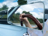 Hand in mirror of a car — Stock Photo
