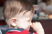 Boy rubbing his nose — Stock Photo