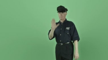 Policeman gesturing shield stop sign — Stock Video