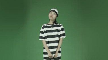 Asian woman prisoner  fingers crossed — Stock Video