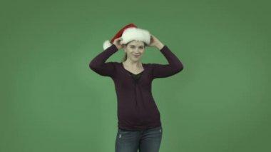 Niña caucásica en sombrero de la navidad — Vídeo de Stock