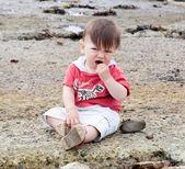 Boy eating stones — Stock Photo