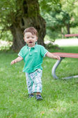 Boy playing in a garden — Stock Photo