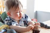 Boy eating a birthday cake — Stock Photo