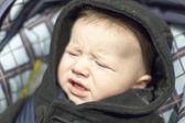Baby boy sulking — Stock Photo