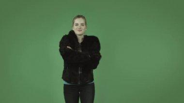 Girl in coat standing confident — Stock Video