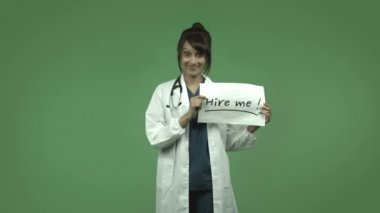 Female doctor with hire me sign — Stock Video