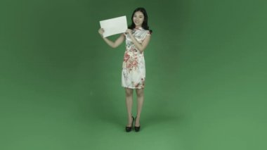 Woman in chinese dress with blank sign — Stock Video