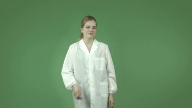 Girl in lab coat with call me hand sign — Stock Video