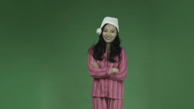 Young asian woman in pajamas — Stock Video