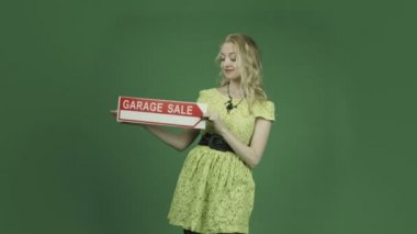 Woman in dress with garage sale — Vídeo de stock