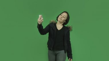 Girl in winter jacket taking selfie — Stock Video
