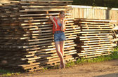 Portrait girl model near wood shelf — Stockfoto